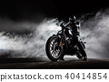 High power motorcycle chopper with man rider at night 40414854