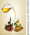 Olive oil with flying olives in wooden bowls 40414892