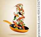 Fresh sea food and vegetables flying into a pan on brown background 40415567