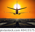 Silhouette from a landing airplane at the runway. 40415575