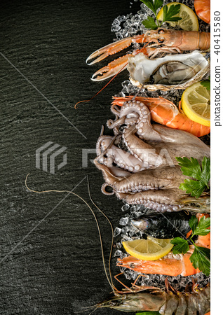 Seafood served on black stone 40415580