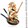 Fresh sea food and vegetables flying into a pan on white background 40415654