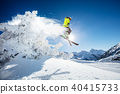Skier at jump in Alpine mountains 40415733