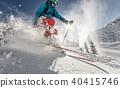 Man freerideer running downhill 40415746