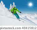 Skier on piste running downhill 40415812