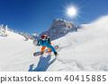Snowboarder running downhill 40415885