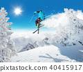 Skier at jump in Alpine mountains 40415917