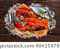 Many kind of seafood, served on crushed ice, placed on old wooden planks 40415979