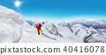 Man skier running downhill 40416078