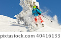 Freeride skier in powder snow running downhill 40416133