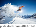 Snowboarder at jump in Alpine mountains 40416141