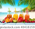 Fresh smoothie drinks placed on wooden planks, blur beach on background 40416159