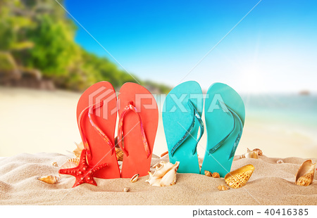Tropical beach with colored flip flops, summer holiday background. 40416385