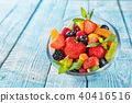Fresh fruit salad served on wooden table 40416516