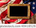 Close-up of USA flag in grunge design with woden blackboard for copyspace. 40416526