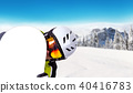 Snowboarder holding his snowboard off piste 40416783