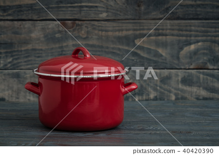 New And Clean Covered Red Saucepans on Blue 40420390