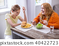 Smiling slim woman having lunch with her friend 40422723