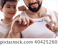 toothbrush, son, father 40425260