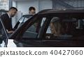 Family taking seats in new car in salon 40427060