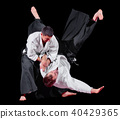 Two martial arts fighters 40429365