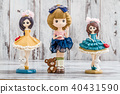 Decorative Cute Dolls on White Wooden Background 40431590