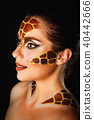 Girl with make-up giraffe 40442666