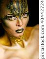 Girl with unusual makeup crocodile 40442724