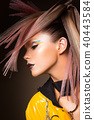 Fashion model woman. Portrait of beautiful party girl with trendy make-up, haircut. 40443584
