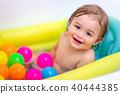 Baby boy taking bath 40444385