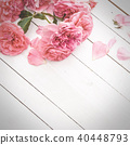 Romantic pink roses on white wooden background 40448793
