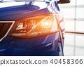 The headlights and hood Blue car 40458366