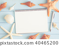 notebook with starfish and sea shells on blue wood 40465200