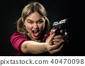 girl with gun 40470098