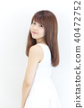 Young lady's hair style 40472752