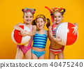 funny funny happy children  jumping in swimsuit  jumping  on col 40475240