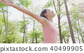 woman feel free in forest 40499905