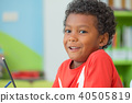 African American kid holding group of color pencil 40505819