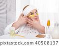 Serious fat woman making an eye mask 40508137