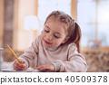 Nice positive girl holding a pencil 40509378