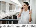 Glad woman sharing business idea by phone 40510968