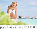woman on tropical beach 40511109