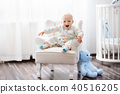 Baby boy in bedroom. Kids room. Bed for child. 40516205