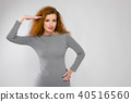 Attractive woman in dress greeting 40516560