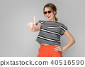 Woman in fashionable clothes and sunglasses 40516590