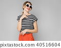 Woman in fashionable clothes and sunglasses 40516604