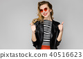 Attractive woman in fashionable clothes 40516623