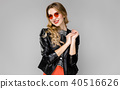 Attractive woman in fashionable clothes 40516626