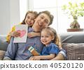 daughters congratulating dad 40520120