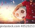 Boy playing football 40520253